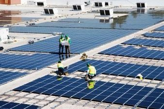 Workers Install Solar Panels on Walmart Store